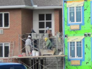 The brick layers are back - building the new exterior for the new stairwell.